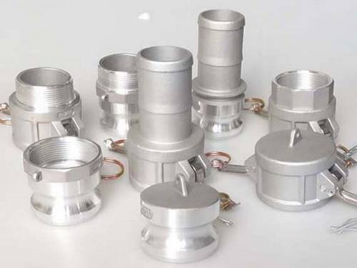 Eight different ypes and sizes aluminum camlock couplings on the gray background.