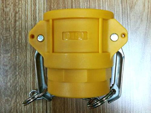 Yellow nylon camlock coupler type D has two stainless steel handles.